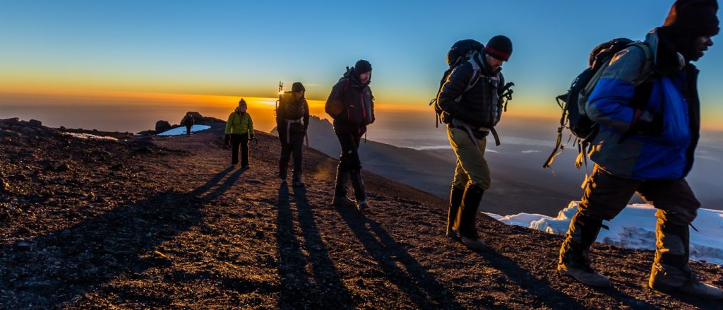 climbers on Kilimanjaro during sunrise