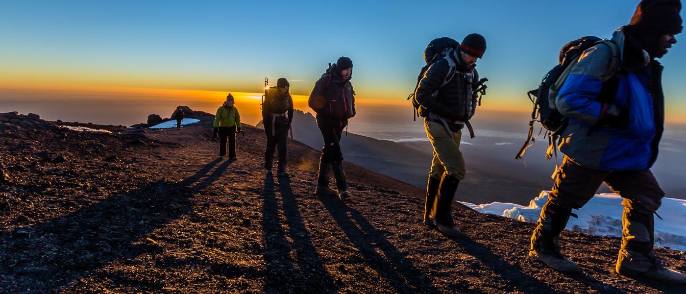climbers on Kilimanjaro during sunrise