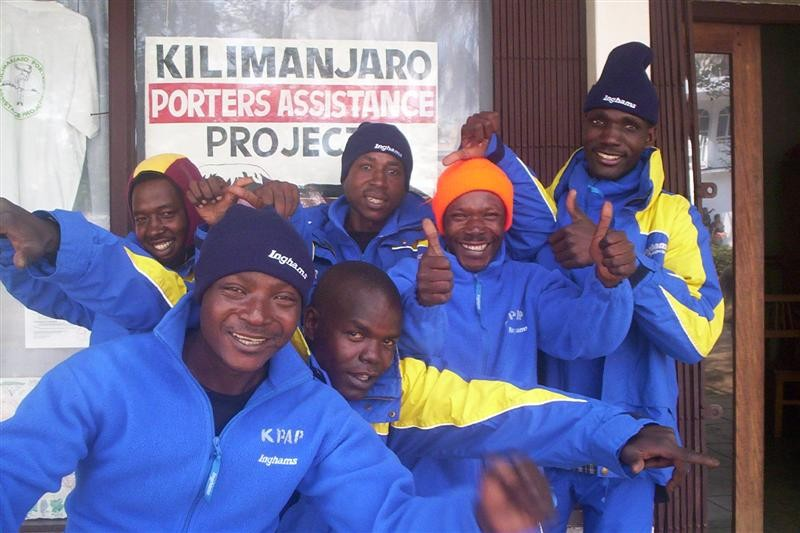 porters in front of the KPAP sign