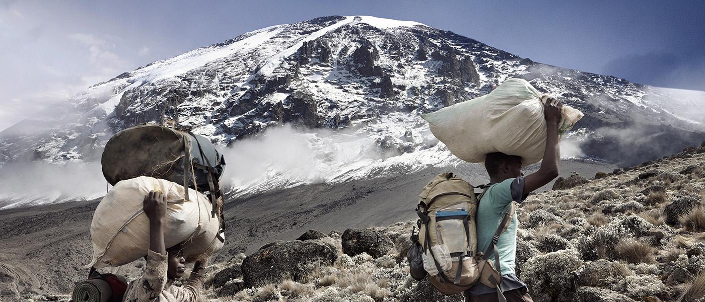 porters walking up kilimanjaro